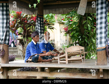 Men playing gambang kayu Stock Photo