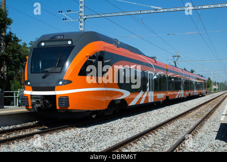 Front/side view of a modern urban short line electric train - Stock Photo