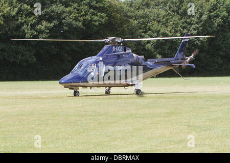 Biggin Hill,UK,3rd August 2013, The helicopter prepares to leave after Bear Grylls & David Walliams visit to Campdowne - Stock Photo