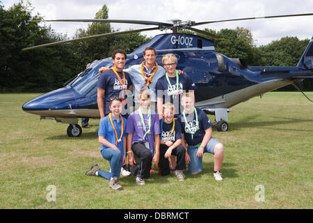 Biggin Hill,UK,3rd August 2013, Bear Grylls poses with scouts in front of a helicopter after his visit to Campdowne - Stock Photo