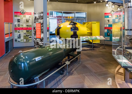 Models of atomic bombs 'Little Boy' (foreground) and 'Fat Man' (yellow), Bradbury Science Museum, Los Alamos, New - Stock Photo