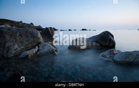 L'Erée rocks tide island guernsey channel islands - Stock Photo