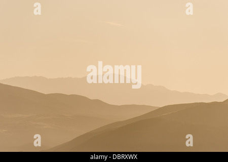 The low mountains on the skyline at Temecula, Calfornia, in the haze and early morning light. - Stock Photo