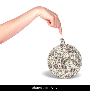 Financial crisis - an old bomb with a hand made out of dollar bills - Stock Photo