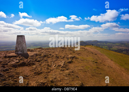 The trig point on the summit of Worcestershire Beacon 1,395ft, highest point of the Malvern Hills, England, UK - Stock Photo