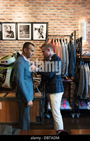 customer and salesperson, Stitched Men's Clothing Store Stock Photo ...