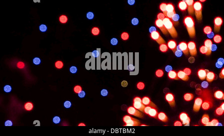 Colorful fireworks in the night sky - Stock Photo