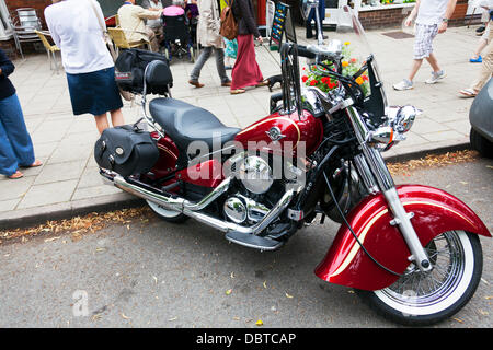 Victory bike motorbike red motorcycle tourer parked on road side  Credit:  Paul Thompson Live News/Alamy Live News - Stock Photo
