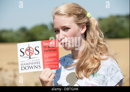 Young wind turbines protester supporting a campaign saying no to wind farm at Hampshire Downs England UK - Stock Photo