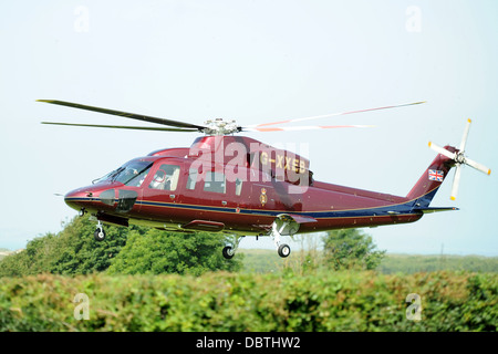 The royal family's helicopter also known as the Queen's Helicopter Flight (TQHF) Sikorsky G-XXEA - Stock Photo