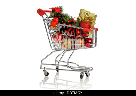 Shopping cart full with Christmas items isolated in white - Stock Photo