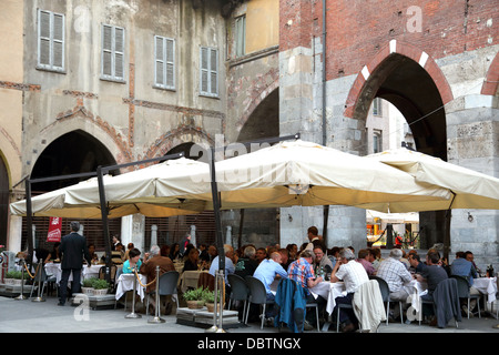 Outdoor restaurant in Piazza Dei Mercanti in Milan Italy - Stock Photo