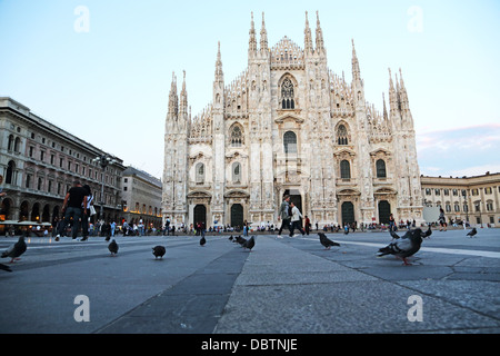 Piazza del Duomo and the front entrance of the Duomo in Milan Italy - Stock Photo
