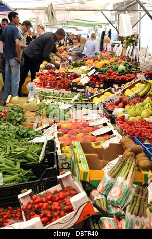 Local people shopping for fruit and vegetables in the for Milan food market