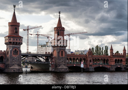 Twin towers of the Oberbaumbrucke, a red brick, double-decker rail and road bridge over the river Spree -  Kreuzberg, - Stock Photo