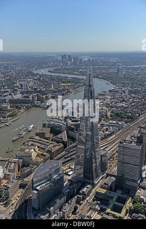 Aerial photograph of London looking from the Shard east along the River Thames with tower bridge and Canary Wharf - Stock Photo