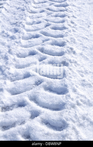 Details of Tire / Tyre Tracks in the Snow - Stock Photo