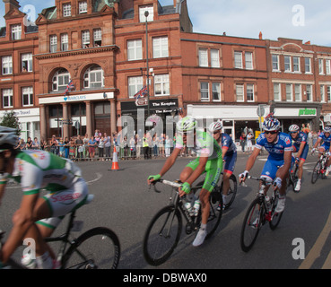 World class professional rides speed through Wimbledon Village in the London Surrey Classic race - Stock Photo