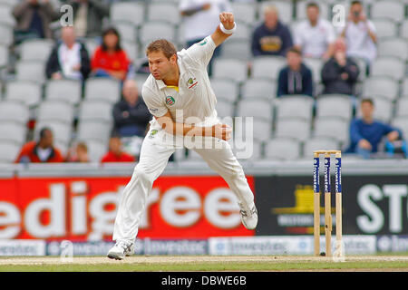 Manchester, UK. 05th Aug, 2013. Ryan Harris bowling during day five of the Investec Ashes 4th test match at Old - Stock Photo