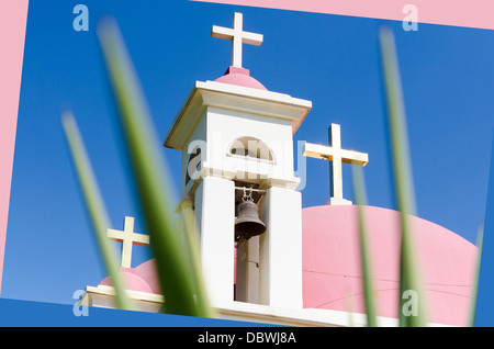 Pink domes and golden crosses on Greek Orthodox Church of the Seven Apostles in Capernaum - Stock Photo