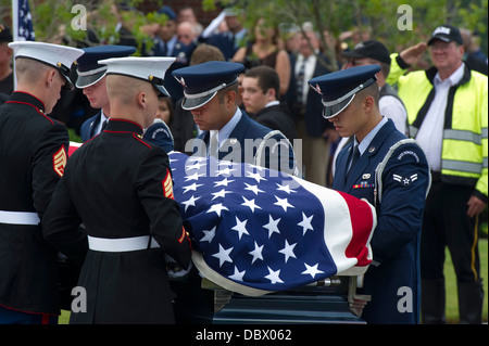 Honor guard of Airmen and Marines, carry the casket of retired Medal of Honor recipient US Air Force Col. George Bud Day during his funeral service at Barrancas National Cemetery August 1, 2013 on Naval Air Station Pensacola, FL. Day, a Medal of Honor recipient and combat pilot with service in World War II, Korea and Vietnam, passed away July 27 at the age of 88.