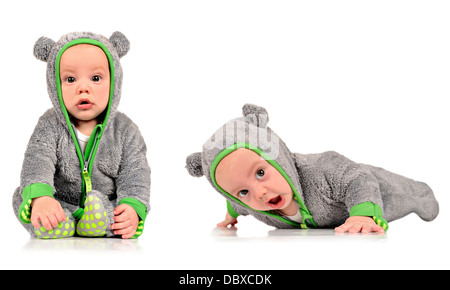Six month old identical twin brothers - Stock Photo
