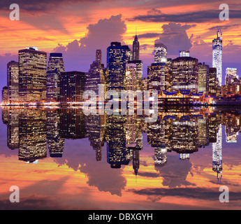 Lower Manhattan with dramatic skyline overhead. - Stock Photo