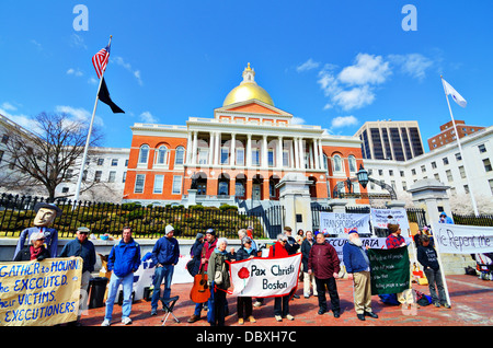 BOSTON - APRIL 6: Protestors at Massachusetts State House April 6, 2012 in Boston, MA. The building was completed - Stock Photo