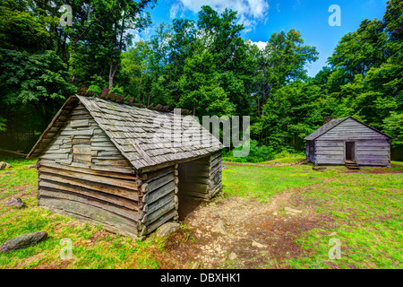 Log cabins at Roaring Fork Motor Trail in Great Smoky Mountains National Forest. - Stock Photo