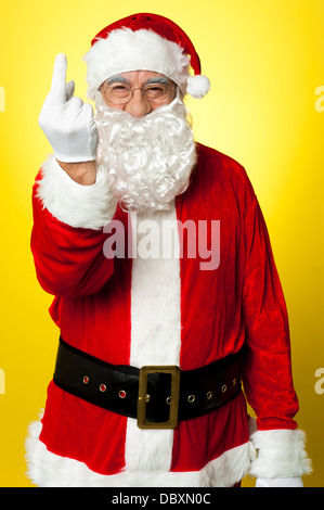 Angry Santa showing middle finger - Stock Photo