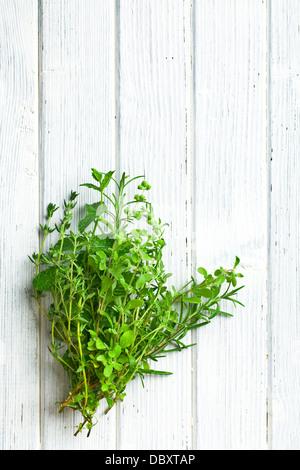 various herbs on kitchen table - Stock Photo