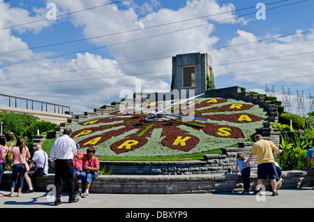 Visitors to the Niagara area stop to see the Floral Clock, a beautiful working timepiece made from thousands of - Stock Photo
