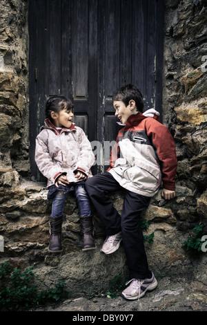 Children having fun outside home - Stock Photo