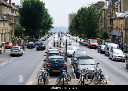 View looking down Second Avenue with parked cars toward the seafront in Brighton East Sussex England UK - Stock Photo