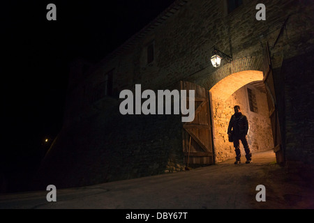 Man standing outside the gate of the medieval city