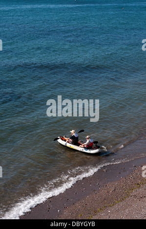 paddling,casting off,Teignmouth,rowing boats, beach,devon,angling,fishing,beach, boats, coast, de - Stock Photo