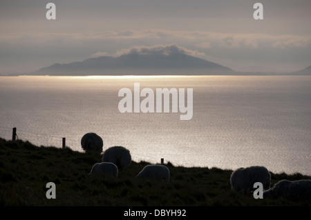 The Western Isles over the waters of the Minch with Neiss Point, Duirinish, on the Isle of Skye in the foreground. - Stock Photo