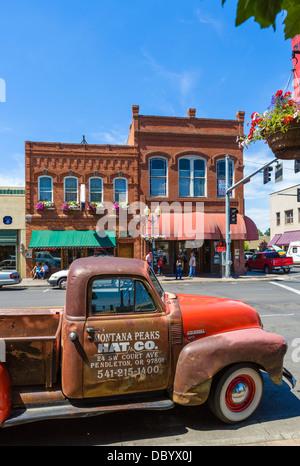 Old Chevrolet Advance Design 3100 truck on Main Street in downtown Pendleton, Oregon, USA - Stock Photo
