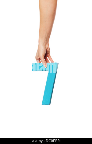 hand holding up the number seven from the top - Stock Photo