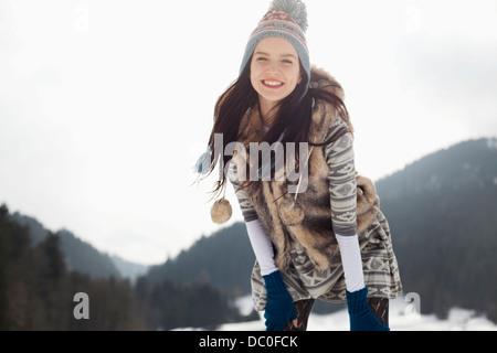 Portrait of happy woman in snow - Stock Photo