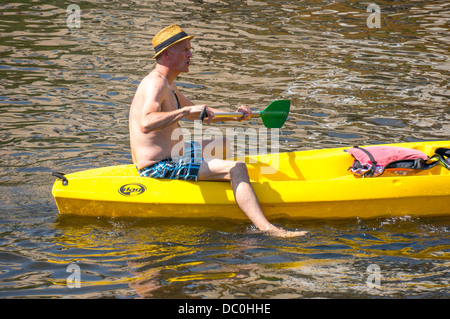 Man in a hire canoe on the river Dronne in the commune of Brantôme, in the Dordogne department in south west France, - Stock Photo