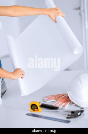 architect with blank blueprint - Stock Photo