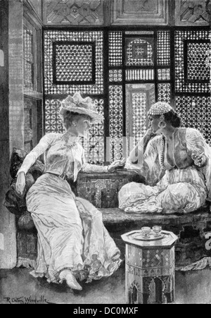 A VISIT TO THE HAREM JAUNARY 1900 COVER HARPER'S MONTHLY ELEGANT VICTORIAN WOMAN TALKING WITH ARABIC WOMAN BY WINDOW - Stock Photo