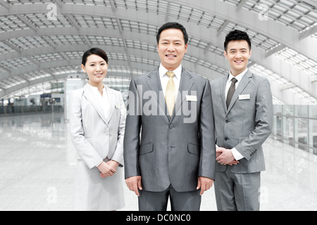 Confident business team at the airport - Stock Photo