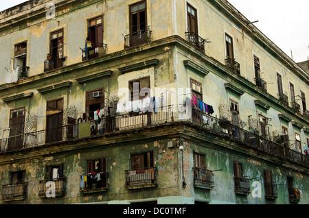 Central Havana 19th century apartment building, windows, balconies, laundry, in disrepair - Stock Photo