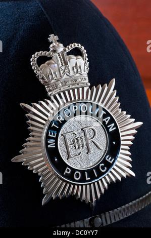 Close view on Metropolitan Police helmet badge interior situation - Stock Photo