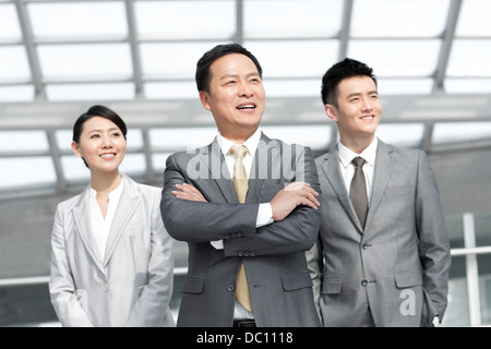 Portrait of business team at the airport - Stock Photo