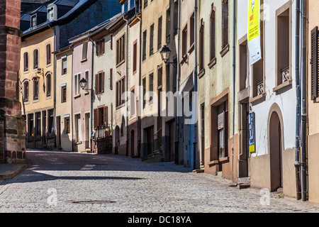 A picturesque medieval cobbled street in the pretty village of Vianden in Luxembourg.