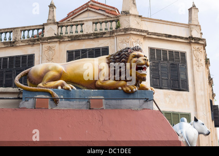 scenic lion sculpture on the wall of Sri Mariamman Temple located in Chinatown of Singapore - Stock Photo