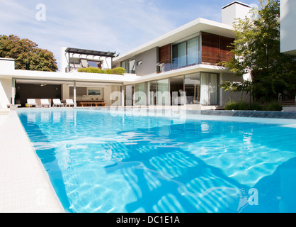 Modern house and swimming pool - Stock Photo